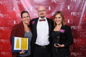 Imagine's media relations specialist, Tiffannie Bond, and director of media relations, Melissa Biernacinski, pictured with PRSA Las Vegas' president, James Stover, APR.